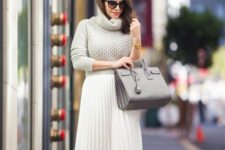 13 a cropped dove grey sweater, a white pleated midi skirt, white heels and a grey bag