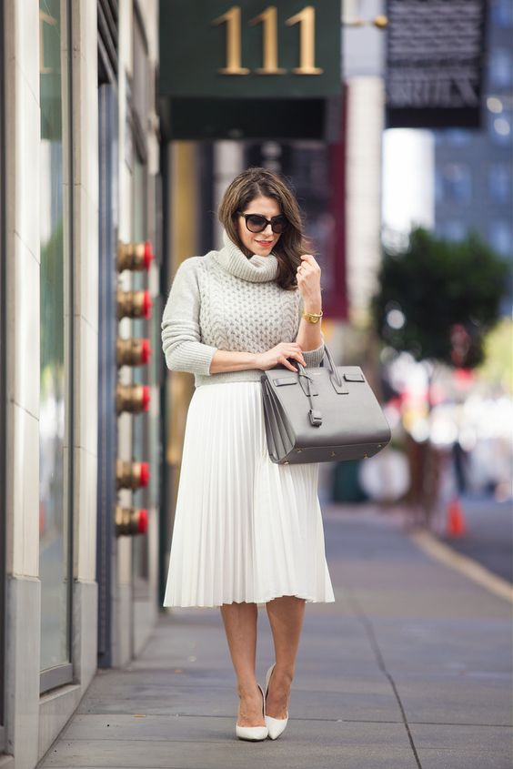 a cropped dove grey sweater, a white pleated midi skirt, white heels and a grey bag