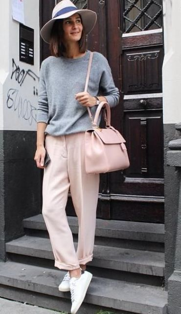 a grey sweatshirt, blush trousers, white sneakers, a blush bag and a hat