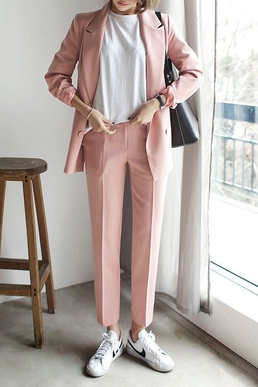 a pink pantsuit, a white tee and white sneakers for a creative job