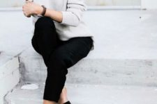 13 black jeans, black flats, a neutral sweater for a simple office-ready look