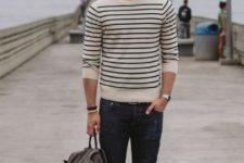 13 dark denim, beige shoes, a striped top with long sleeves and a backpack
