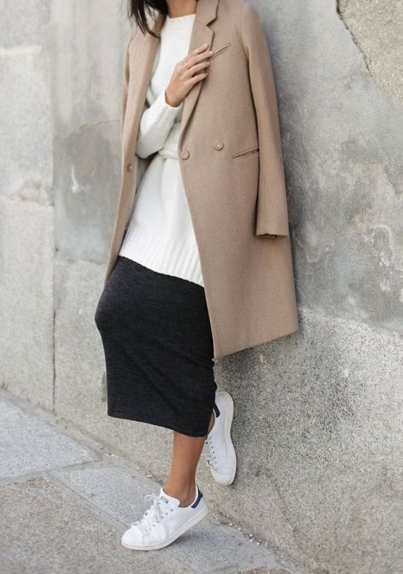 a black midi skirt, a white sweater, a camel coat and white sneakers