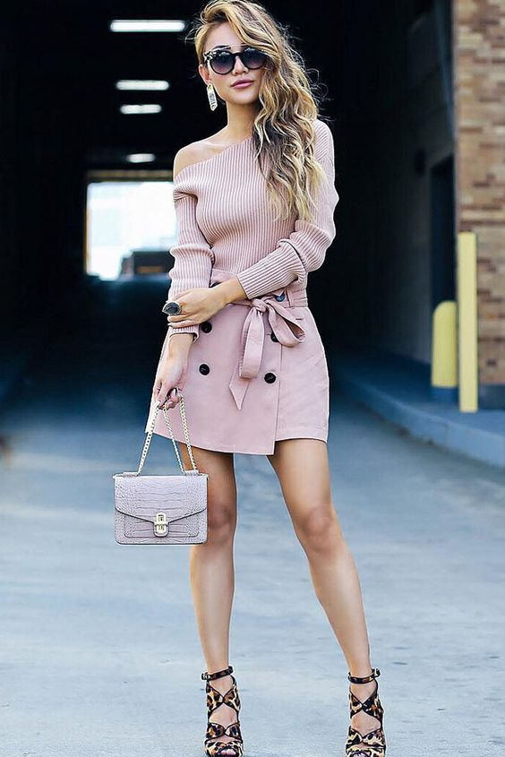 a pink one shoulder top, a matching button down skirt, a neutral bag and pinted shoes