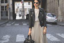 14 a white tee, a blush pleated midi, black platform boots and a black bag, a black leather jacket