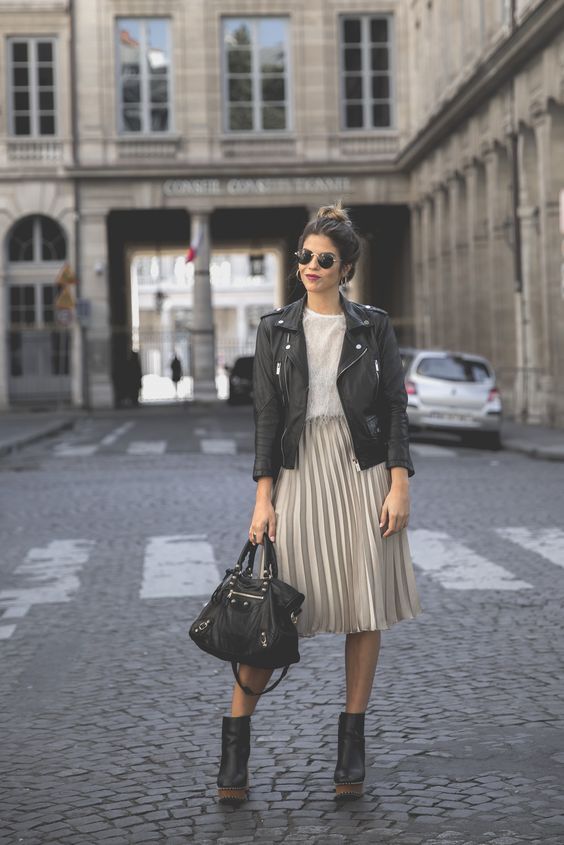 a white tee, a blush pleated midi, black platform boots and a black bag, a black leather jacket
