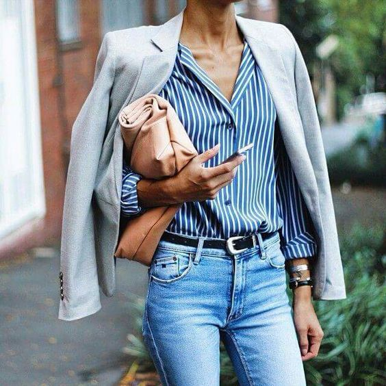 blue jeans, a vertical striped shirt in blue and white, a dove grey jacket