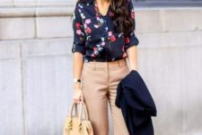 14 tan trousers, a navy floral blouse, a navy blazer, black heels and a small tan bag