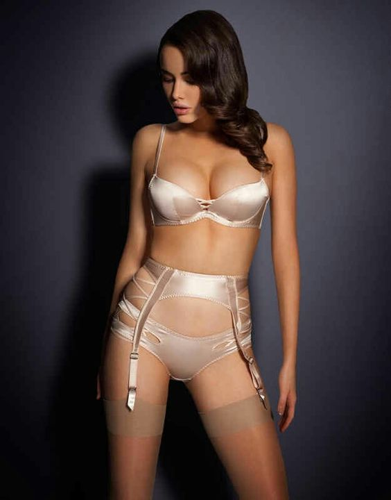 a chic pearly lingerie set with a garter belt and stockings