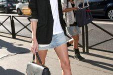 15 a long black blazer, a white tee, a denim mini skirt, black booties and a bag