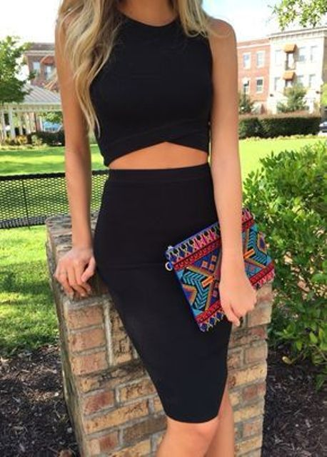 a sexy black crop top outfit with a pencil knee skirt and a geo edge top plus a bold clutch