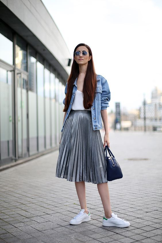 f0d511d247 Picture Of a white top, a grey pleated midi skirt, a blue denim jacket and  white sneakers for a rock feel