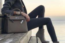 15 dove grey boots, a dark grey blazer, grey jeans, a grey bag for a wow effect