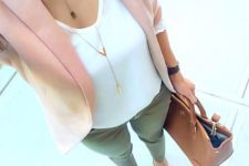 15 olive green pants, a white top, a blush jacket and shoes and a tan bag