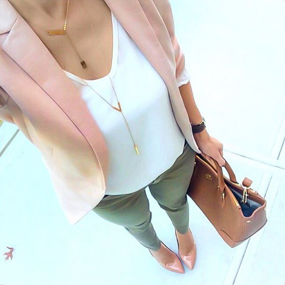 olive green pants, a white top, a blush jacket and shoes and a tan bag