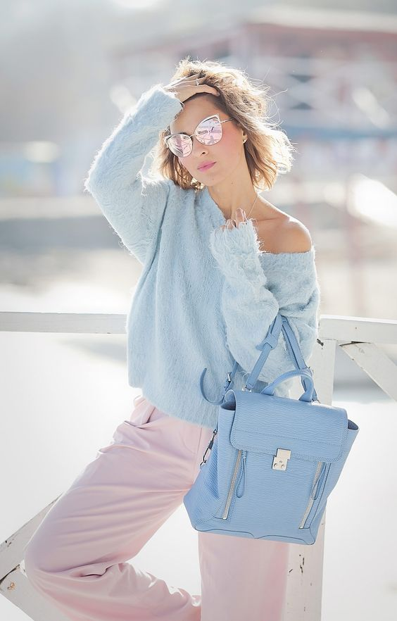 pink pants, a blue one shoulder sweater and a blue backpack to wear right now