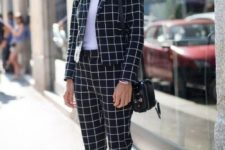 16 a black and white windowpane printed pantsuit, a white top and sneakers