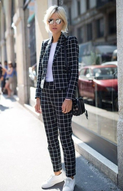 a black and white windowpane printed pantsuit, a white top and sneakers