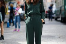 16 a casual dark green jumpsuit with a belt and black shoes