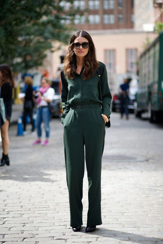 Picture Of a casual dark green jumpsuit with a belt and black shoes