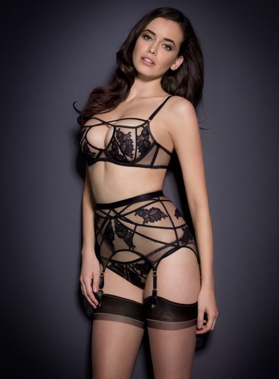 a sexy black lingerie set with straps, a garter belt and stockings