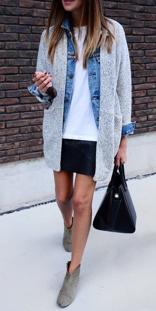 a white tee, a denim jacket, a grey cardigan, a black leather mini and neutral booties