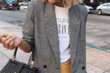 16 a yellow mini skirt, a printed tee, a checked grey blazer, a black bag for a chic casual look
