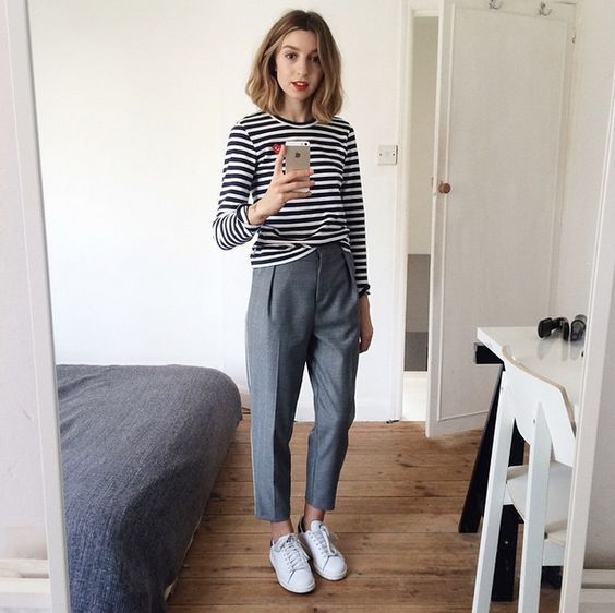 grey cropped trousers, a black and white striped top, white sneakers to go to work
