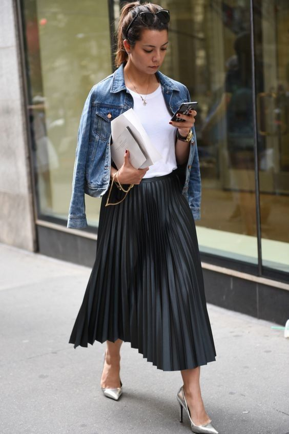 silver shoes, a black pleated midi skirt, a white tee and a cropped denim jacket for a casual yet refined look