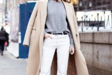 16 white cropped pants, a grey sweatshirt, white heels and a tan coat