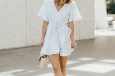With beige sandals and white bag