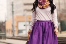 With beige shirt, purple skirt and bag