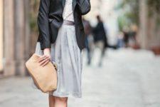 With black blazer, light gray dress and beige clutch