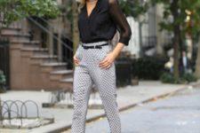 With black blouse, polka dot pants and black belt