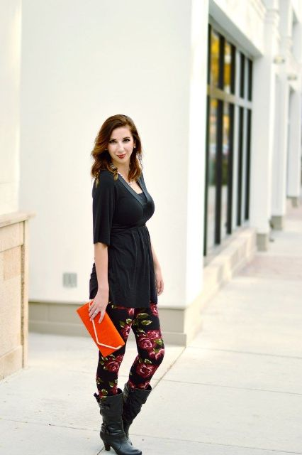 With black blouse, red clutch and black high boots