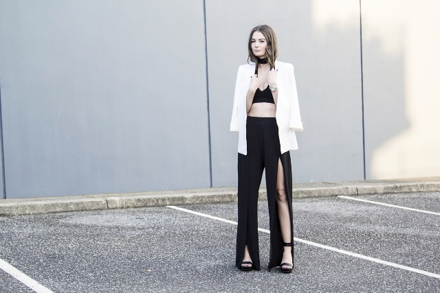 With black crop top, white long blazer and black sandals