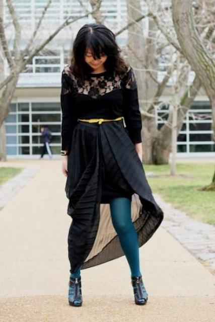 With black lace shirt, yellow belt, colored tights and ankle boots