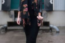 With black leather jacket, black midi skirt, ankle boots and printed bag