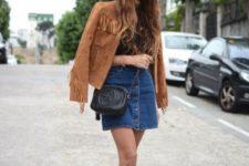 With black shirt, denim skirt, black sandals and bag