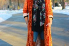 With black shirt, jeans, over the knee boots and orange velvet maxi coat