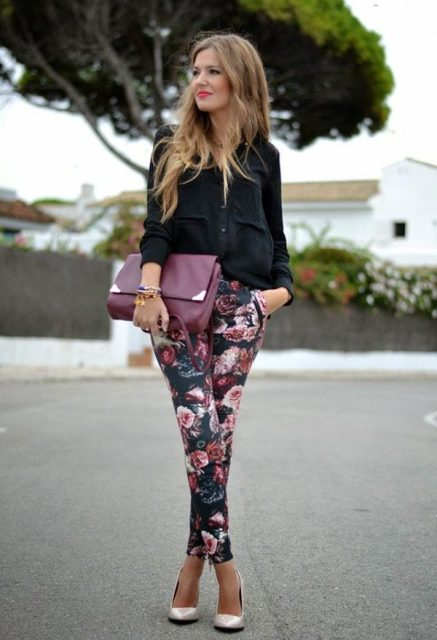 With black shirt, pumps and purple clutch