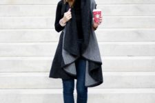 With black shirt, skinny jeans and ankle boots