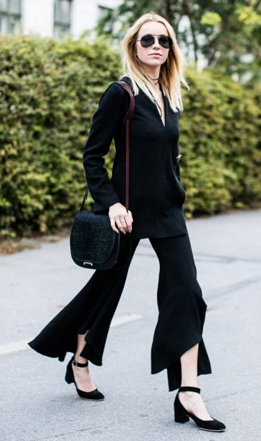 With black shirt, small bag and black shoes
