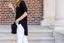 With black shirt, white pants and black bag
