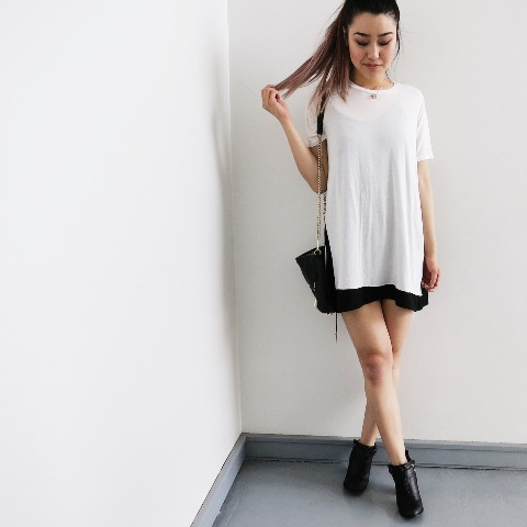 With black shorts, black ankle boots and tote
