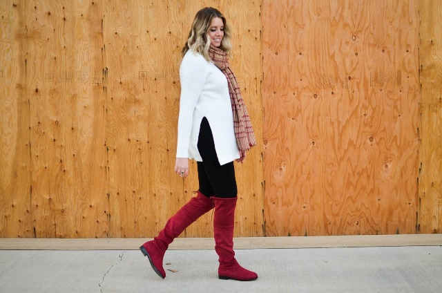 With black trousers, plaid scarf and red high boots