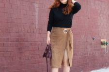 With black turtleneck, black pumps and purple small bag