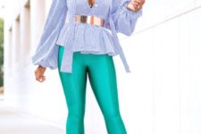 With blouse, metallic belt and beige pumps
