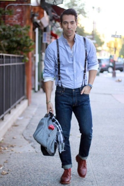 With blue shirt, cuffed jeans, brown boots and bag