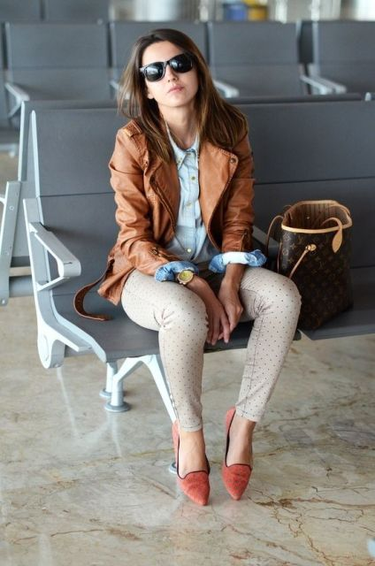 With blue shirt, leather jacket, polka dot pants and printed bag